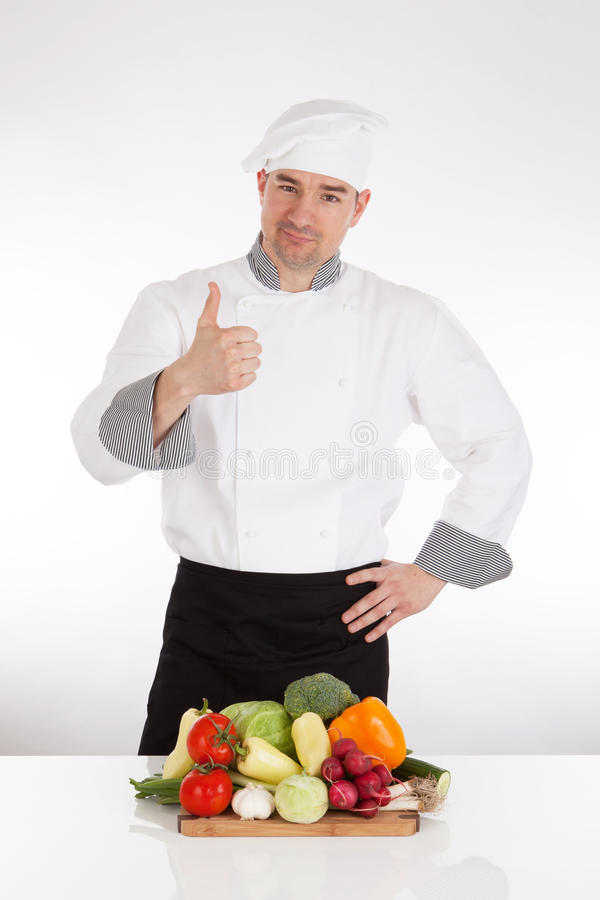 Chef and fresh vegetable. Chef with thumb up and fresh vegetable stock image