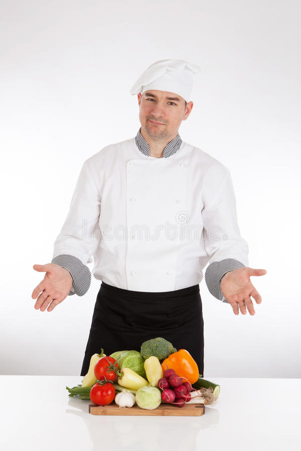 Chef and fresh vegetable. On white backgronud stock images