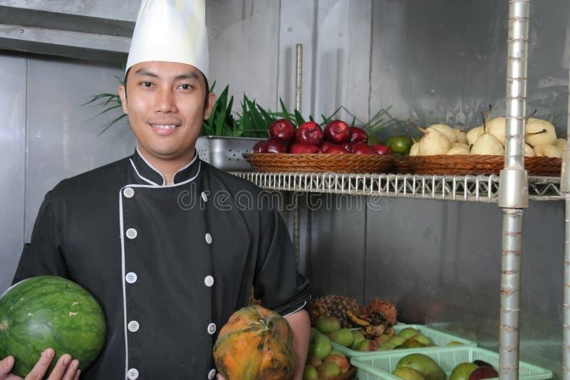 Chef in fruit storage stock photos