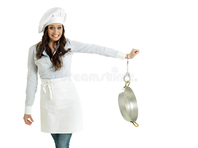 Chef handcuffed to a pot. Smiling chef handcuffed to a pot stock images