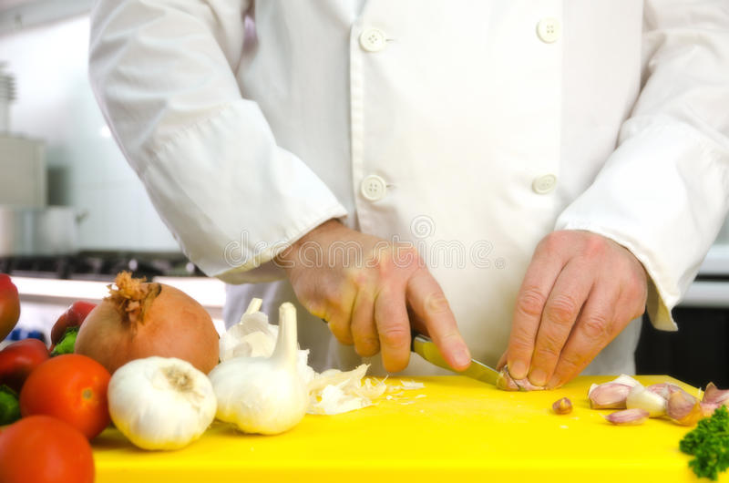 Chef Hands With Garlic Royalty Free Stock Image