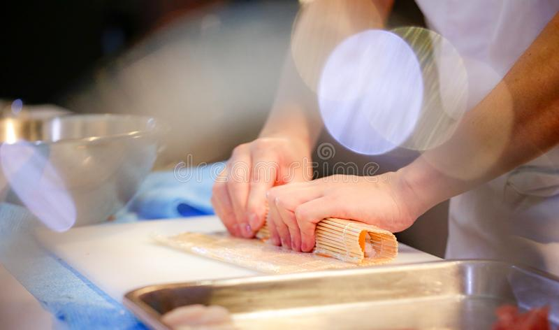 Chef hands preparing japanese food, chef making sushi, Preparing royalty free stock photo