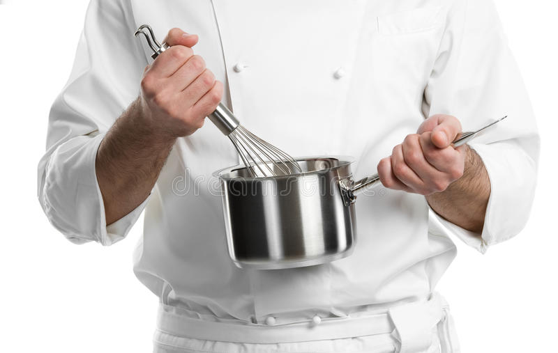 Chef hands with whisk and pan. Professional chef hands with kitchen utensils whisk and pan isolated royalty free stock images