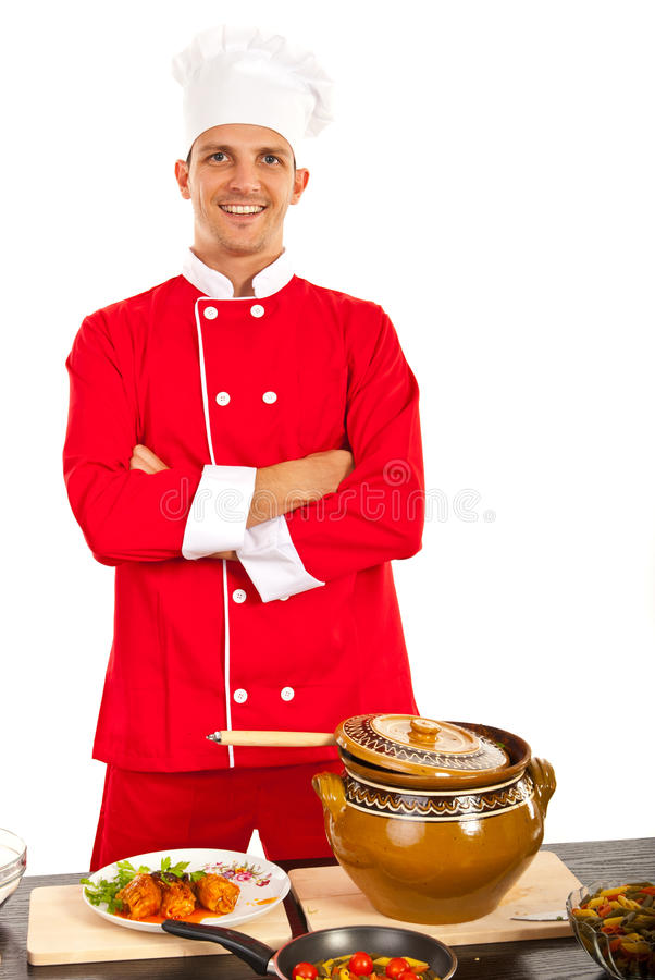 Chef. Happy chef male standing with arms folded in kitchen stock photography