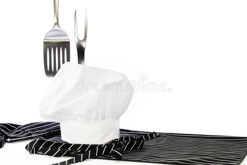 Chef-Hat Apron Spatula-Gabel lizenzfreie stockfotografie