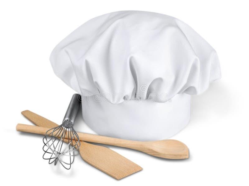 Chef Hat avec des batteries de cuisine photographie stock