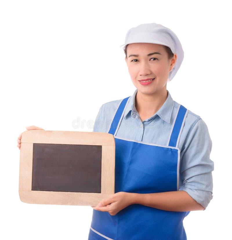 Chef, Hausfrau, die leere Menüzeichentafel oder leeres Zeichen zeigt stockbilder