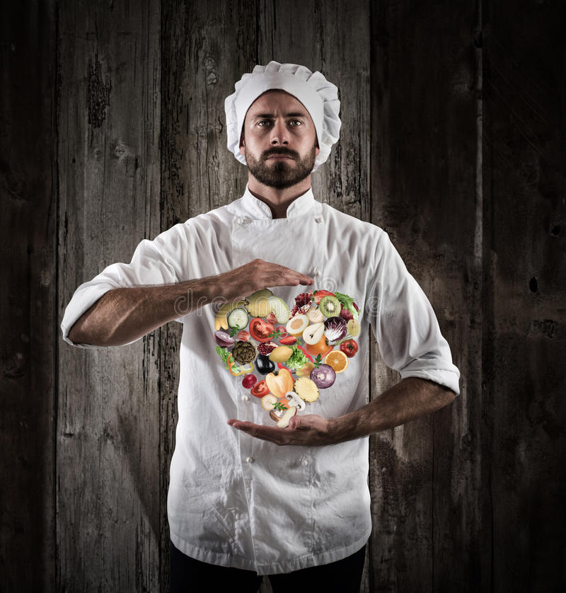 Chef healthy cooking. Chef specialized in vegetarian with fresh vegetables. Healthy food for wellness concept royalty free stock photos