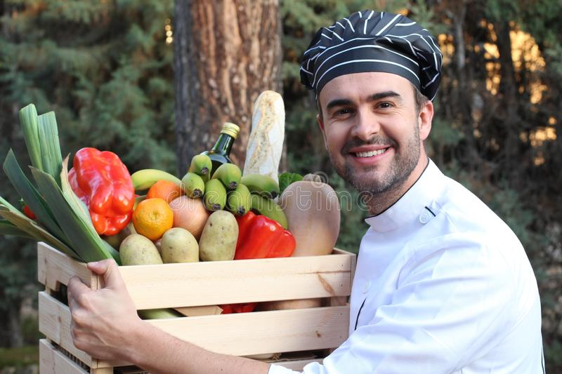 Chef holding box with healthy ingredients stock photo