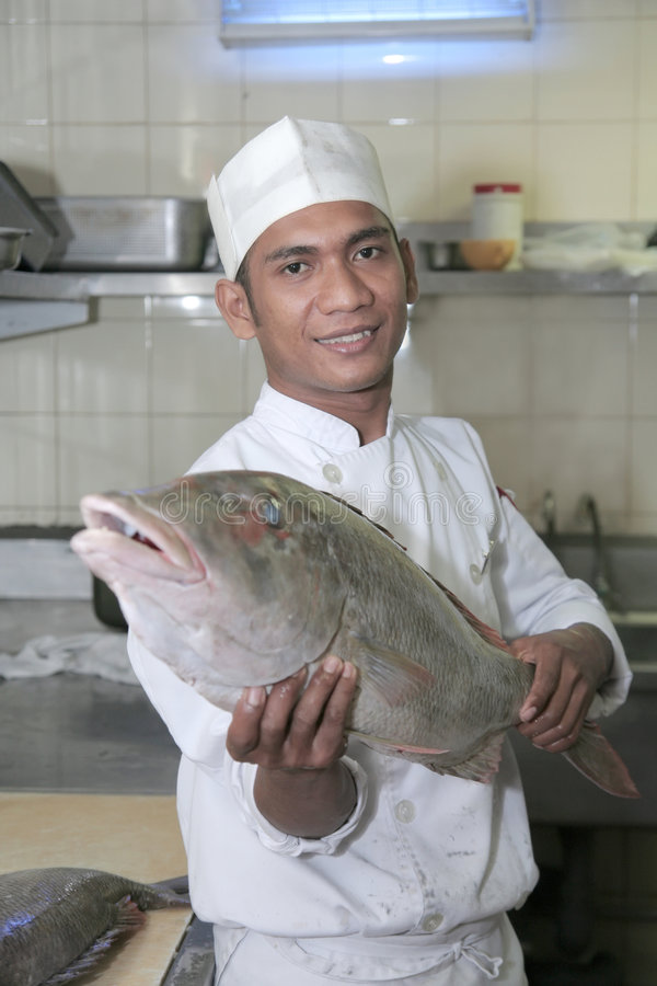 Download Chef Holding Fish At Butcher Stock Photo - Image: 6385766
