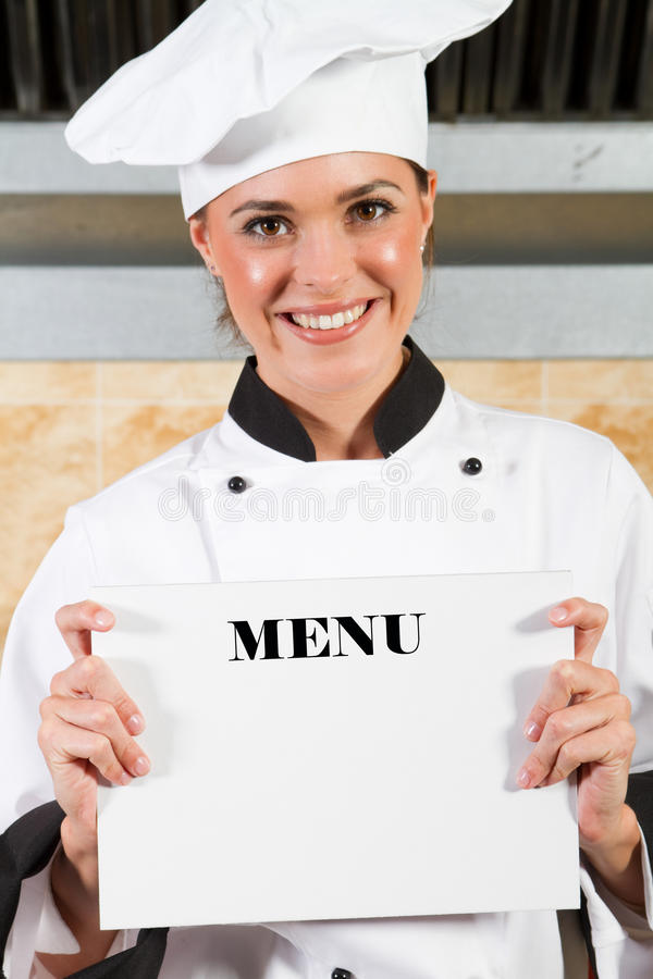 Chef holding menu stock image