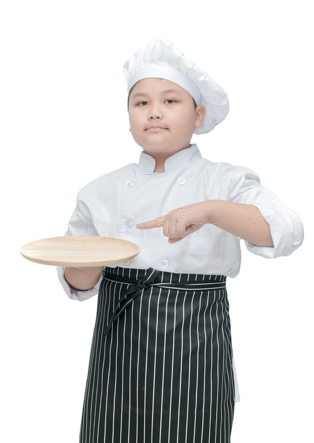 Chef holding and pointing empty wood dish royalty free stock photography