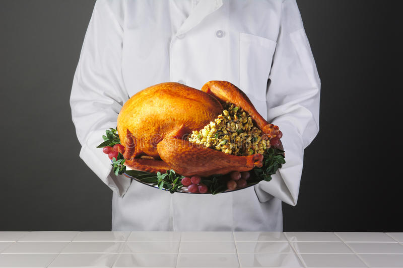 Chef Holding Thanksgiving Turkey on Platter royalty free stock photos