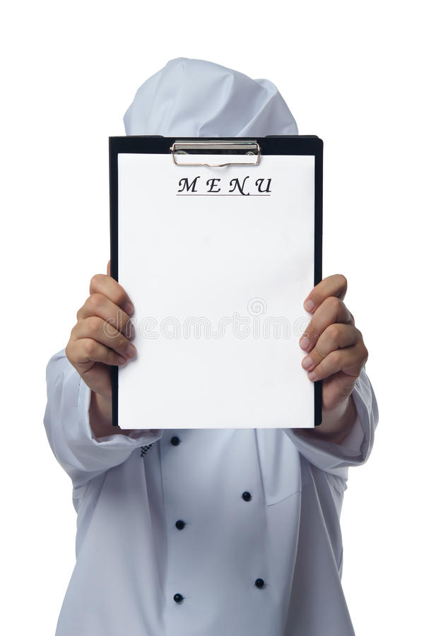 Chef holds a place for your. Menu royalty free stock photo
