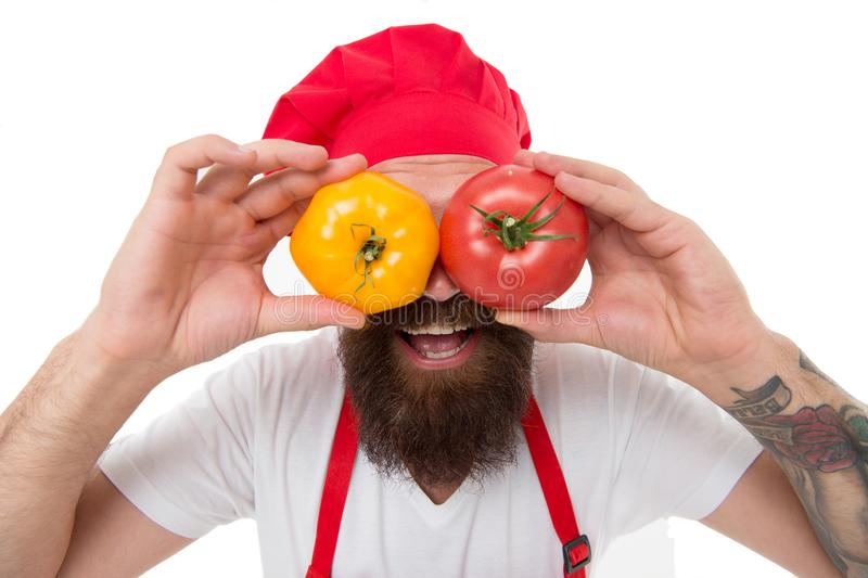 Chef holds tomatoes. Cook in uniform holds vegetables. Ripe tomato for delicious meal. Eat fresh tomato. Pick one stock photos