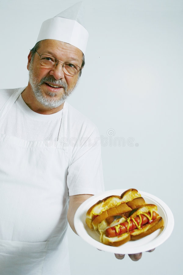 Chef with hot dogs