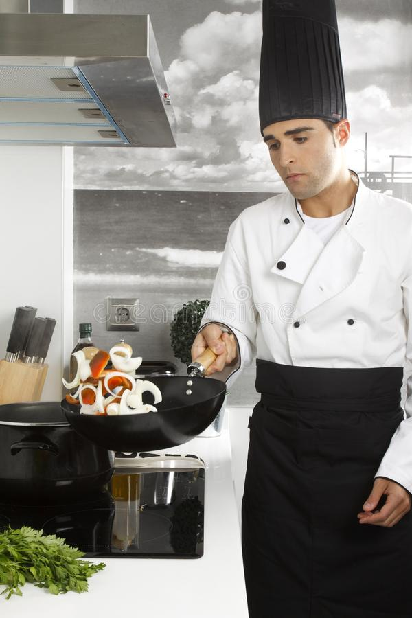 Chef in the kitchen royalty free stock image