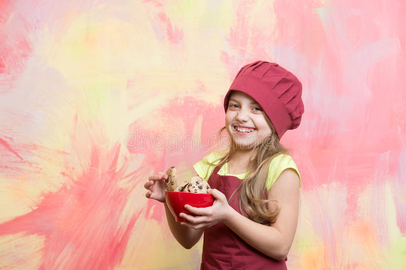 Chef kid in cook hat, apron hold cookies or biscuits stock photo