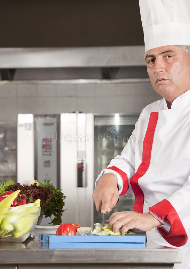 Chef in kitchen stock images