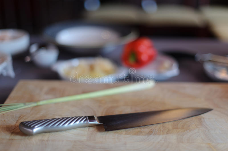 Chef knife with ingredients royalty free stock photography