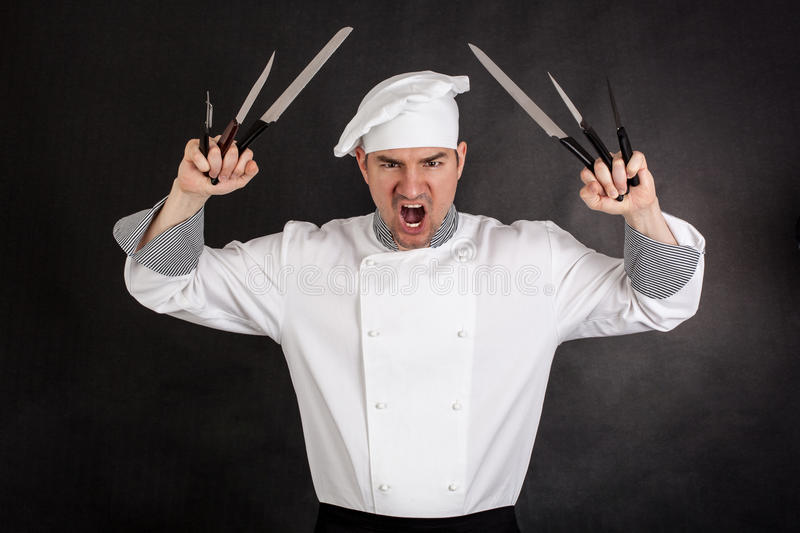 Chef with knifes stock image