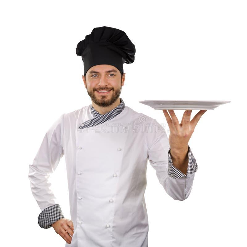 Chef-kok die lege die schotel houden op wit wordt geïsoleerd royalty-vrije stock fotografie