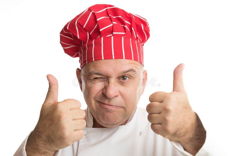 Chef-kok die met rode hoed uitdrukkingen maken stock foto