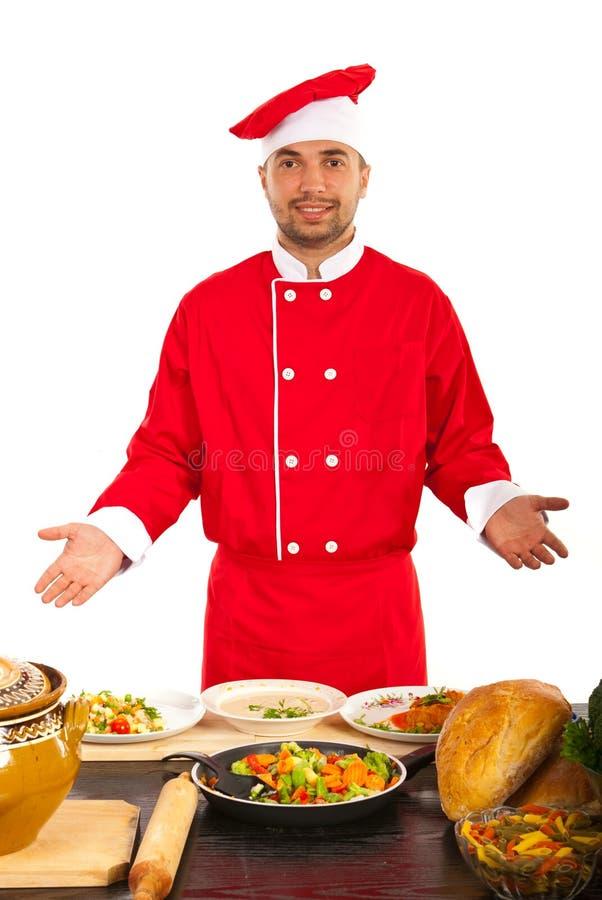 Chef-kok die zijn werk tonen royalty-vrije stock foto
