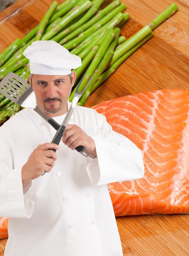 Chef-kok en het gezonde eten stock foto