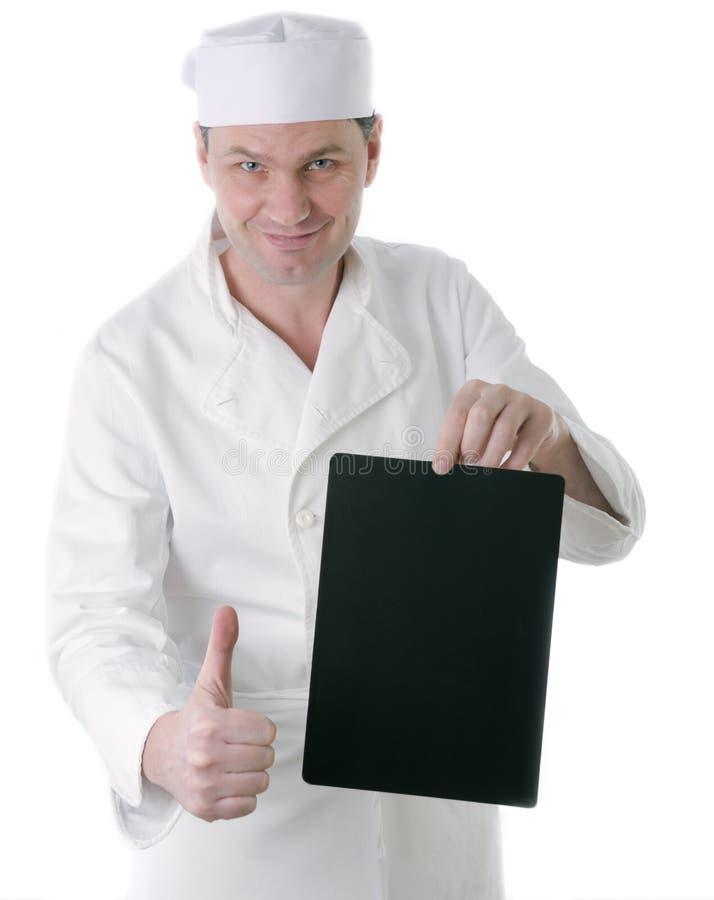 Chef-kok met leeg zwart teken stock foto