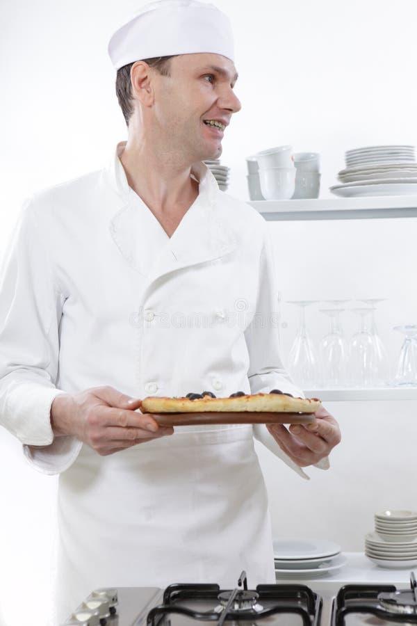 Chef-kok met pizza stock foto's