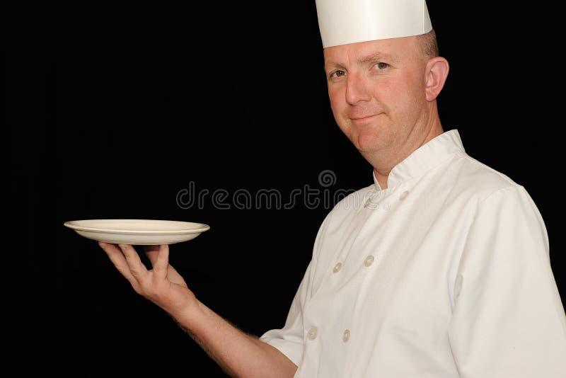 Chef-kok met plaat stock afbeeldingen