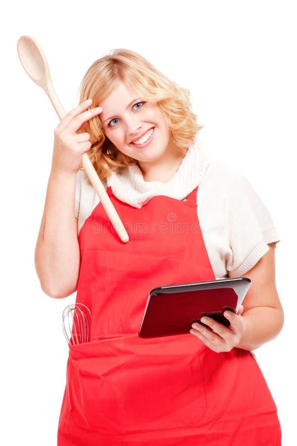 chef-kokkok die een tabletcomputer met behulp van royalty-vrije stock afbeeldingen