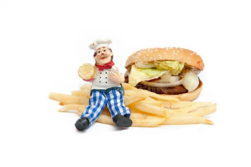 Chef-kokmodel en hamburger royalty-vrije stock foto