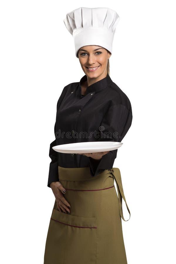 Chef-kokvrouw die lege plaat tonen stock afbeelding