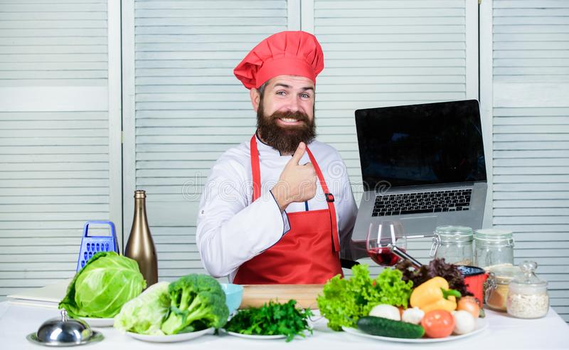 Chef laptop read culinary recipes. Culinary school. Hipster in hat and apron learning how to cook online. Culinary stock photo