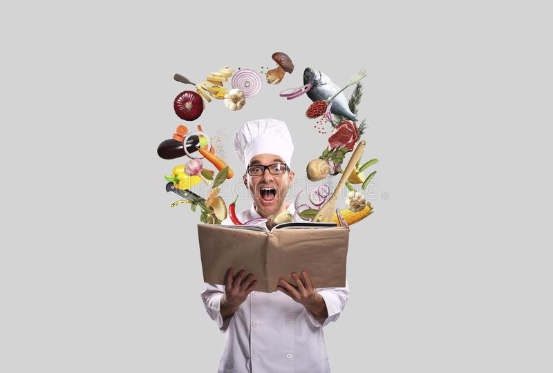 Chef looks at the recipe stock images