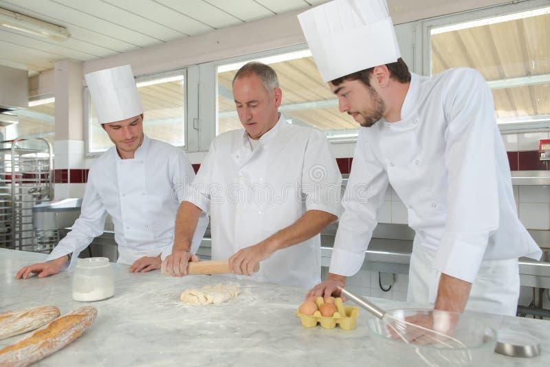 Chef making a dough. Intern stock photos