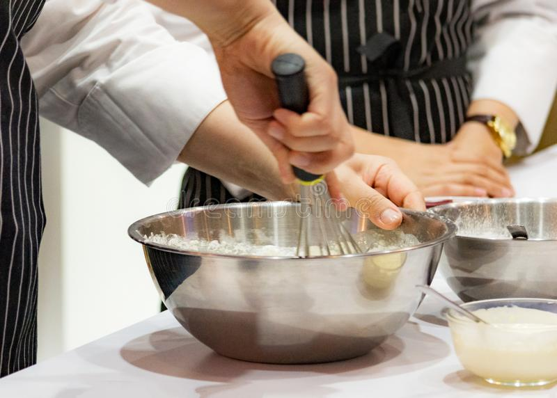 Chef making dough on kitchen, Mixing Butter Milk Pastry Bakery, cook and cake. Background stock photos