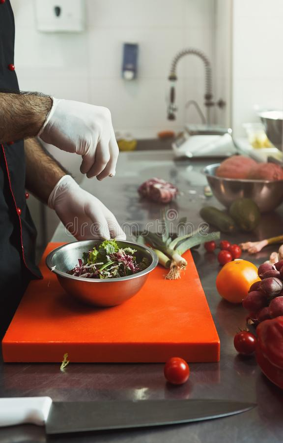 Chef making fresh vegetables mix salad royalty free stock photo