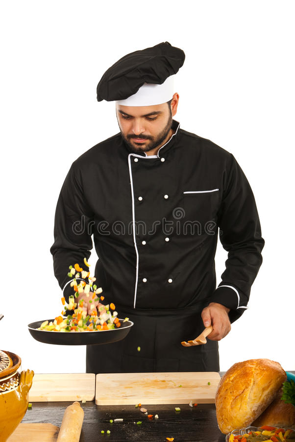 Chef male preparing food. Isolated on white background royalty free stock photography
