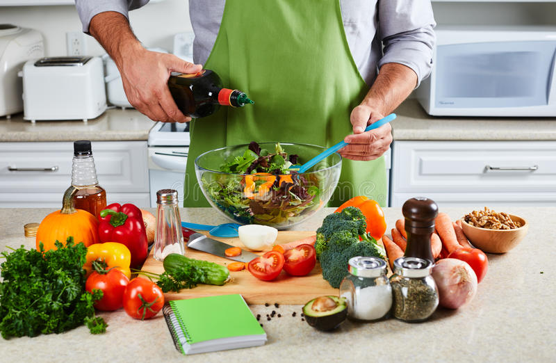 Chef man cooking in the kitchen. Hands of chef man cooking in the kitchen royalty free stock photo