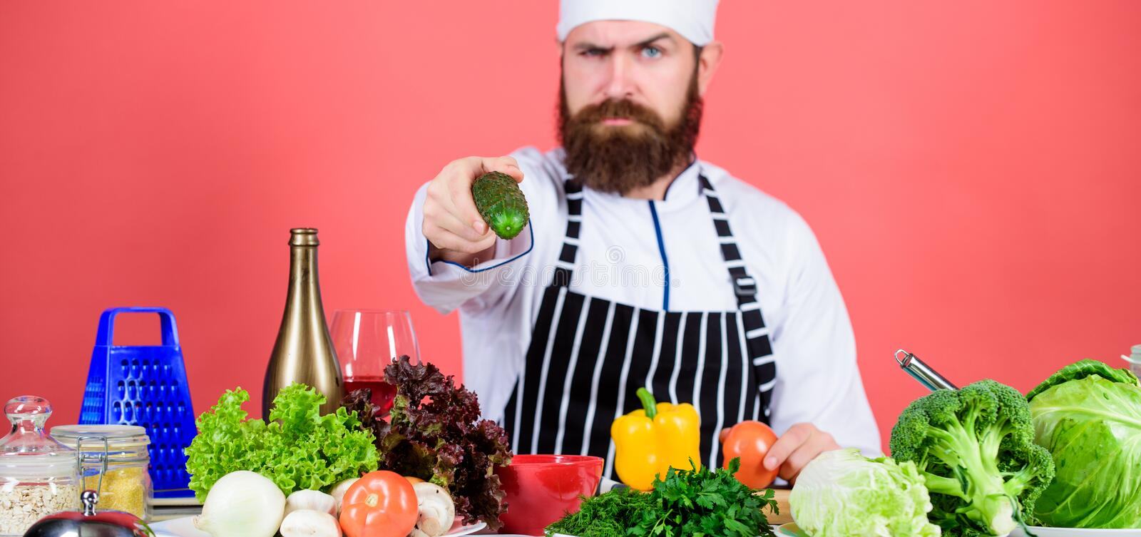 Chef man in hat. Secret taste recipe. Dieting and organic food, vitamin. Vegetarian. Mature chef with beard. Bearded man. Cook in kitchen, culinary. Healthy royalty free stock images