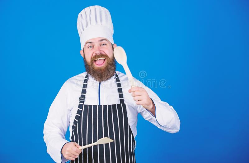 Chef man in hat. Secret taste recipe. Dieting and organic food, vitamin. Vegetarian. Mature chef with beard. Bearded man stock photography