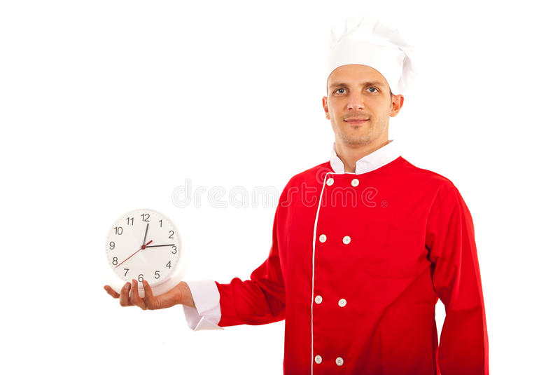Chef man holding clock. Happy chef man holding clock in his palm isolated on white background royalty free stock photos