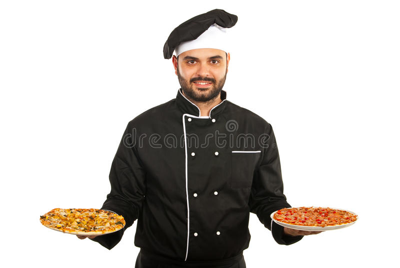 Chef man serving pizza. Happy chef man serving pizza isolated on white background stock photo