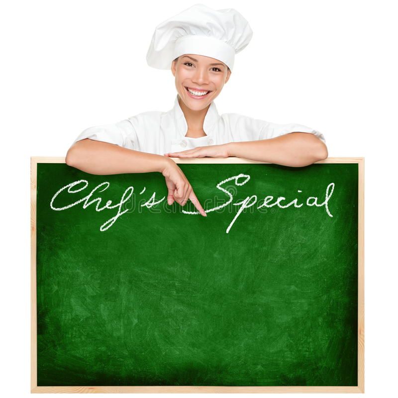 Chef menu sign. Blackboard with copy space for menu items. Beautiful young woman chef holding showing blank chefs special restaurant menu chalkboard isolated on