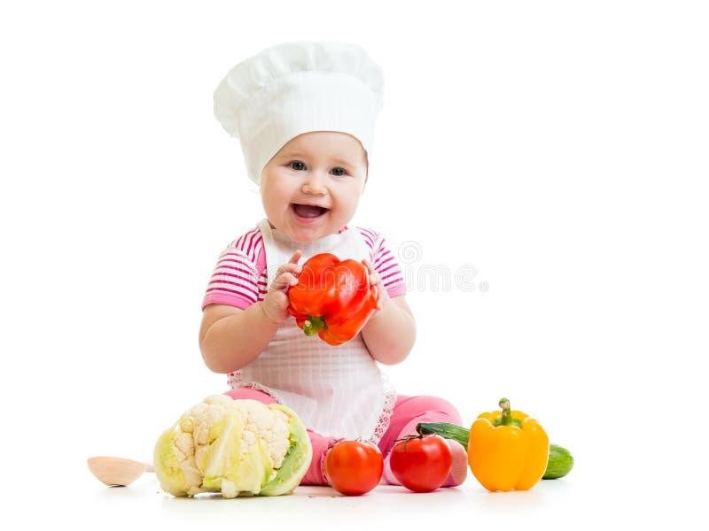 Chef mignon de bébé avec la nourriture saine images libres de droits