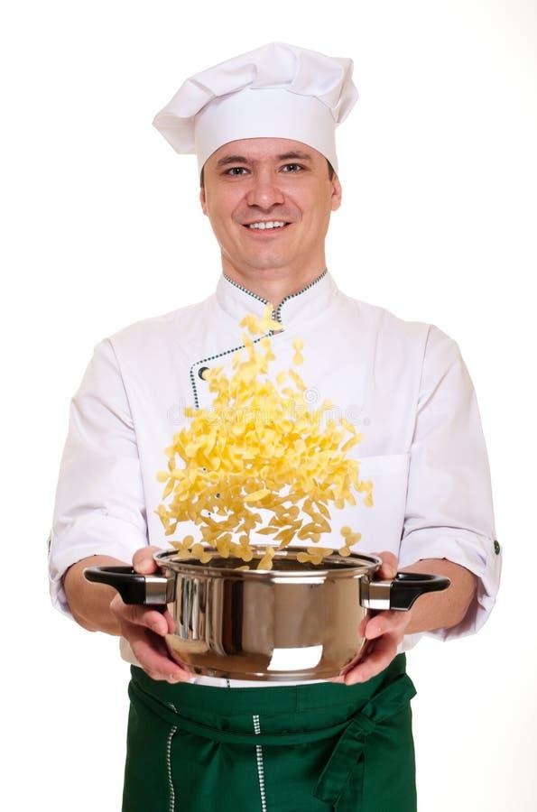 Chef mit dem Teigwarenherausspringen lizenzfreies stockbild