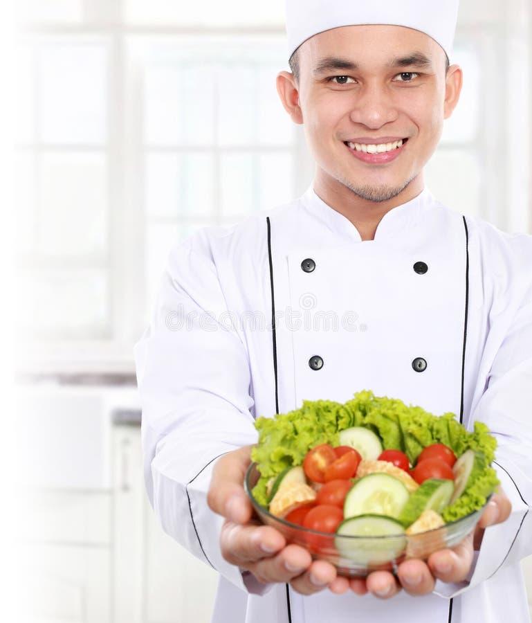 Chef mit gesunder Nahrung lizenzfreies stockfoto